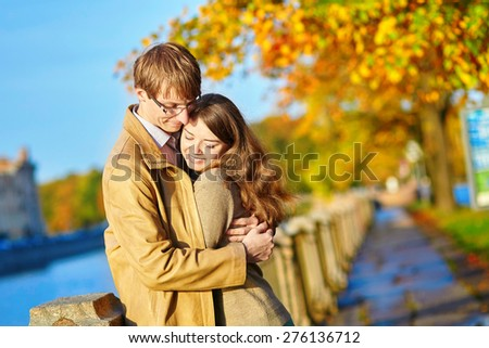 Happy young romantic couple walking together in St. Petersburg, Russia on a warm sunny autumn day - stock photo