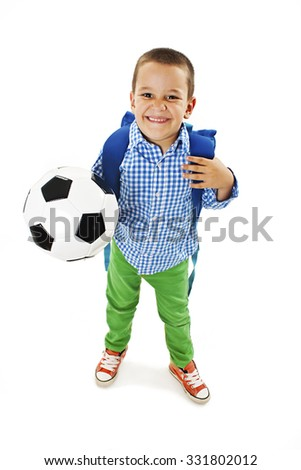 Happy young school boy holding a football. Isolated on white background  - stock photo