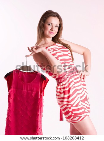 Happy young shopping woman with new dresses - stock photo