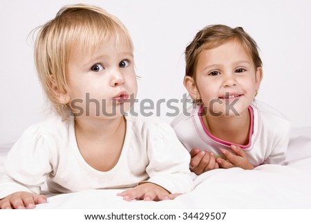 Happy young sisters - stock photo