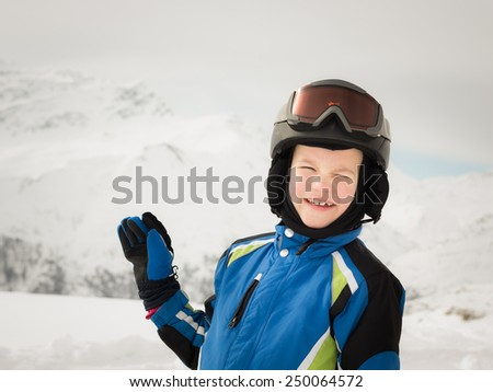 Happy young skier on winter background