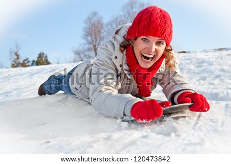 Happy young snowboard girl  on the snow sunny day - stock photo
