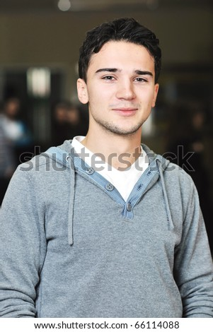 happy young student boy possing at university campus and reopresenting education concept - stock photo