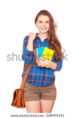 Happy young student girl holding books, high school or college graduand, cute casual teenager smiling, standing isolated on white background, studying at university, back to school, education concept - stock photo