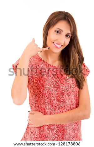 """Happy young student making """"call me"""" sign with hand - stock photo"""