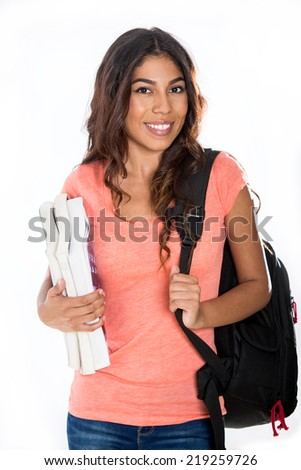 Happy young student with books and backpack - stock photo