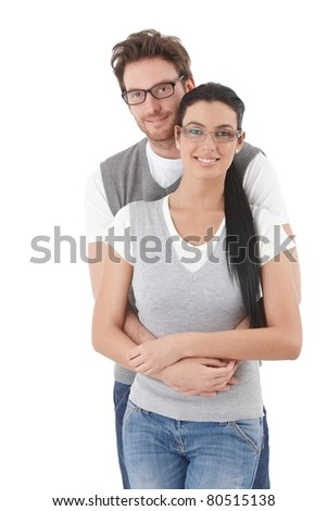 Happy young students hugging each other, smiling.? - stock photo