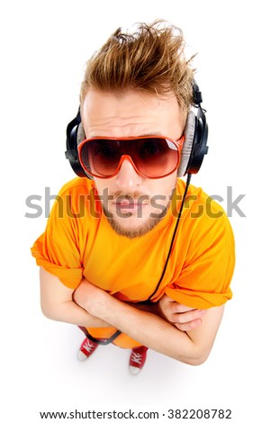 Happy young stylish man in headphones enjoying the music and expressing positivity. Isolated over white. - stock photo