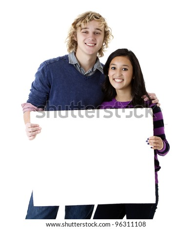 happy young teens holding a blank sign