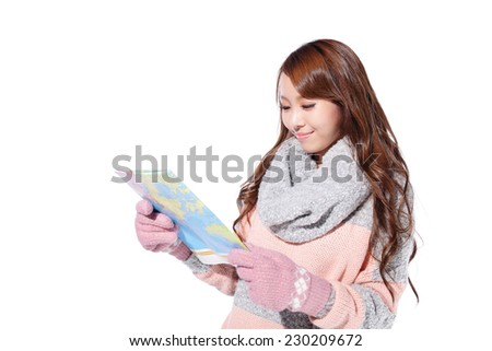 happy young travel woman wearing winter clothing and hold map isolated on white background, asian beauty