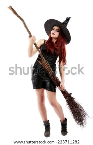 happy young witch with a broom, isolated on white studio background - stock photo