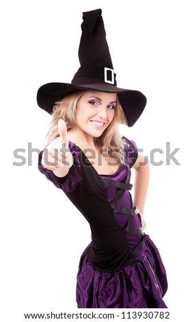 happy young  witch with her thumb up, isolated on white studio background - stock photo
