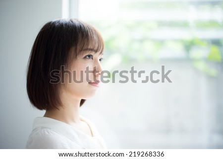 happy young woman at home - stock photo