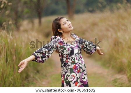 happy young woman breathing in wild nature, thailand - stock photo