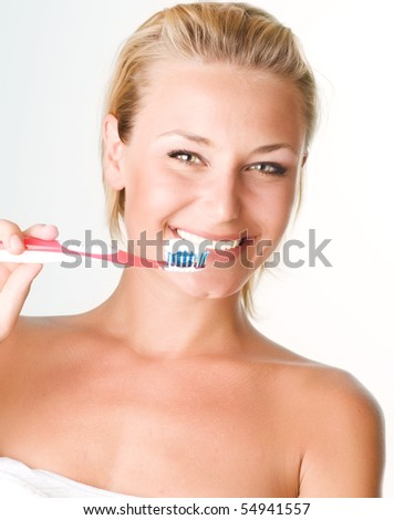 Happy Young Woman Brushing her Teeth - stock photo