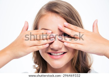 Happy young woman covering her eyes isolated on a white background - stock photo