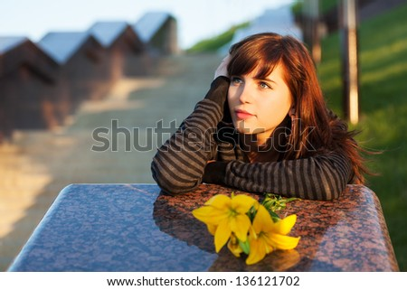 Happy young woman daydreaming - stock photo