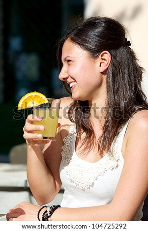 Happy Young Woman Drinking , Italy