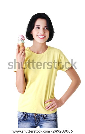 Happy young woman eating an ice cream. - stock photo
