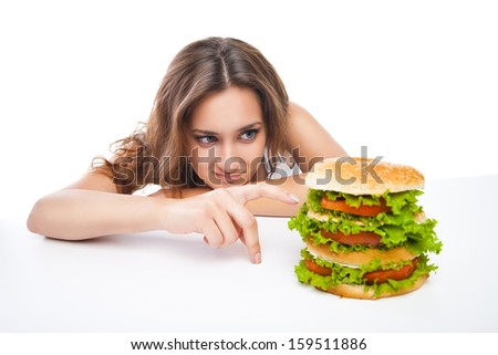 Happy Young Woman Eating big yummy Burger isolated on white background - stock photo