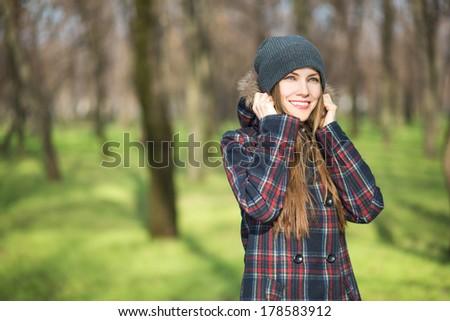 Happy young woman enjoying early spring sunshine - stock photo