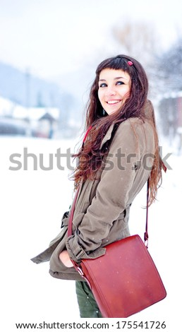 Happy young woman enjoying snow - stock photo
