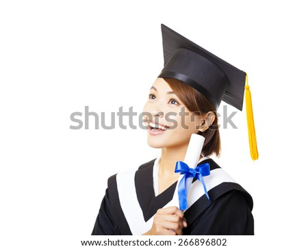 happy young woman graduating holding diploma and looking - stock photo