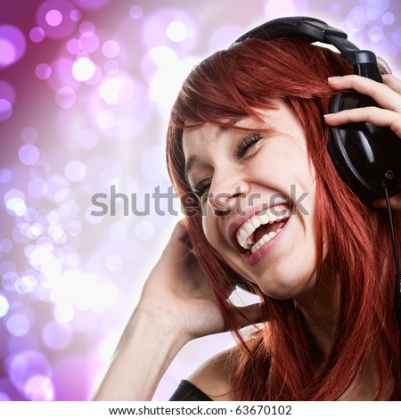 Happy young woman having fun with music headphones - stock photo