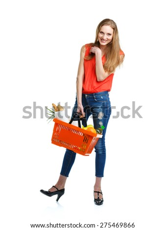 Happy young woman holding a basket full of healthy food on white background. Shopping - stock photo