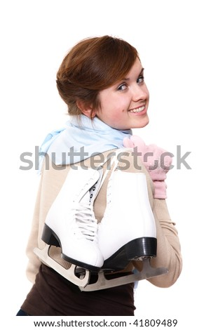 Happy young woman holding figure skates over her shoulder