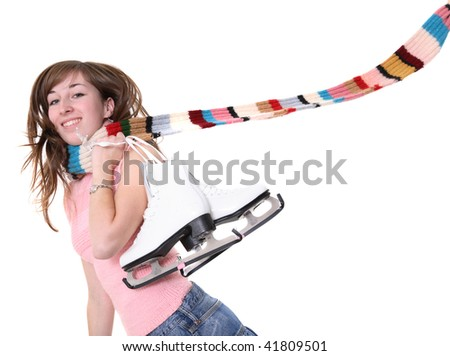 Happy young woman holding figure skates over her shoulder - stock photo
