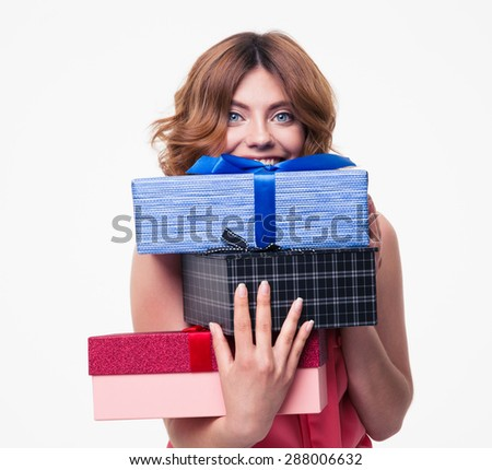 Happy young woman holding gifts isolated on a white background. Looking at camera - stock photo
