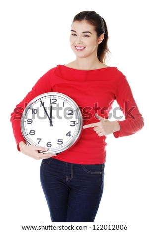 Happy young woman holding office clock, isolated on white background