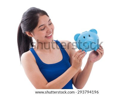 Happy young woman holding piggy bank isolated on white background