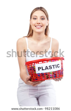 Happy young woman holding red basket in hand. - stock photo