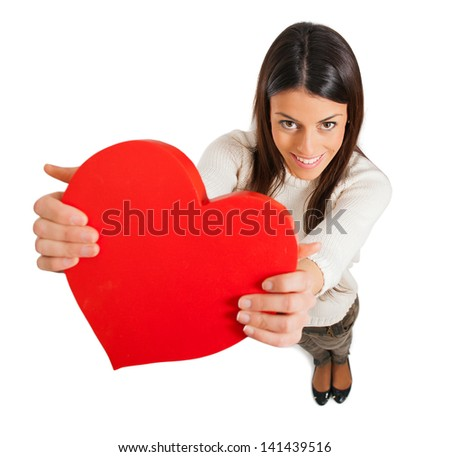happy young woman holding red heart over white background - stock photo