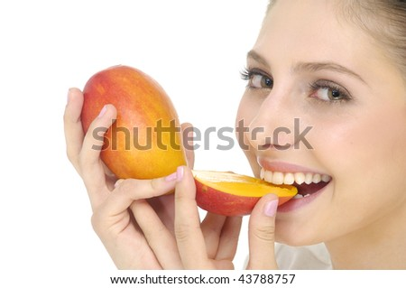 Happy young woman holding ripe mango - stock photo