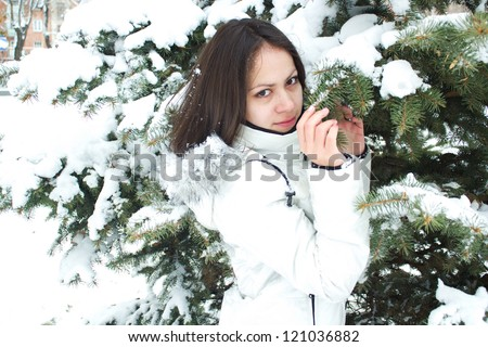 Happy Young Woman Holding the Snow Tree Branch in the  Winter Park - stock photo