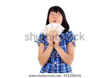 Happy young woman holding up cash euro money in hand smiling and looking at the right, isolated on white background, Positive human emotion, facial expression - stock photo