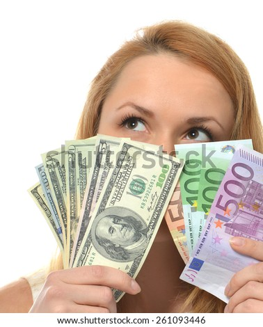 Happy young woman holding up cash money five one fifty hundred euro in one hand and dollars in other compare thinking looking at the corner isolated on a white background - stock photo