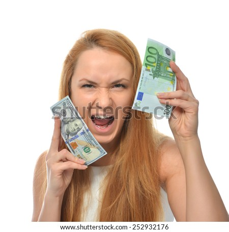 Happy young woman holding up cash money one hundred euro in one hand and dollars in other compare thinking looking at the corner isolated on a white background - stock photo