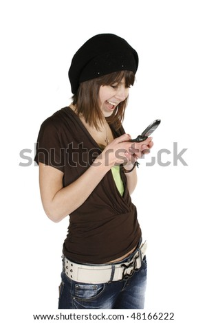Happy young woman in black beret using cell phone isolated on white background