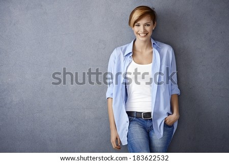 Happy young woman in casual clothes, smiling - stock photo