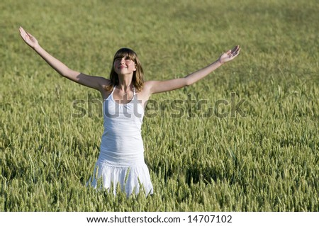 Happy young woman in field
