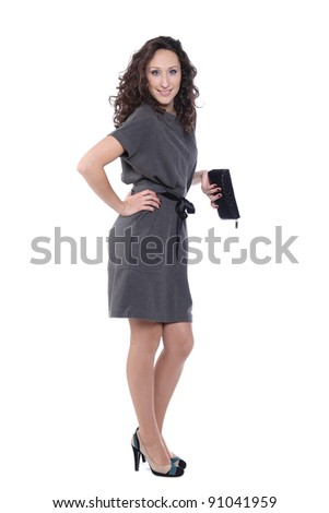 Happy young woman in grey dress