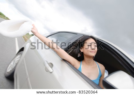 happy young woman in the car on trip road