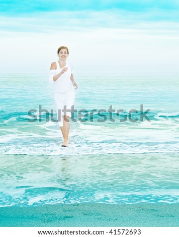 happy young woman is jumping in the beach