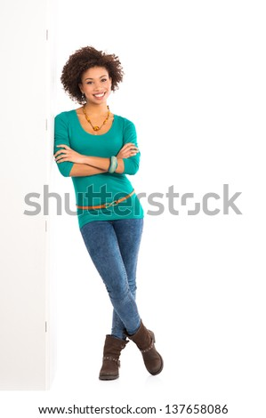 Happy Young Woman Isolated Leaning Against a Panel On White Background - stock photo