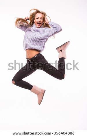 Happy young woman jump  on white background - stock photo