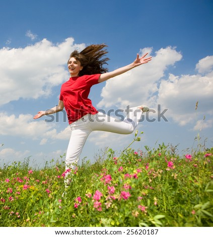 Happy young woman jumping - stock photo